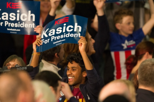 "Nikos Frazier | The Kent Stater A supporter holds a ""Kasich For President"" sign at the Lou Higgins Recreation Center on Tuesday, March 15, 2016. Mintutes later, Gov. John Kasich was announced the winner of the Ohio primary election."
