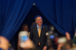 Nikos Frazier | The Kent Stater Ohio Governor and Republican presidential hopeful, John Kasich walks onto the stage at the Lou Higgins Recreation Center in Berea, Ohio after winning the Ohio Primary election Tuesday night.